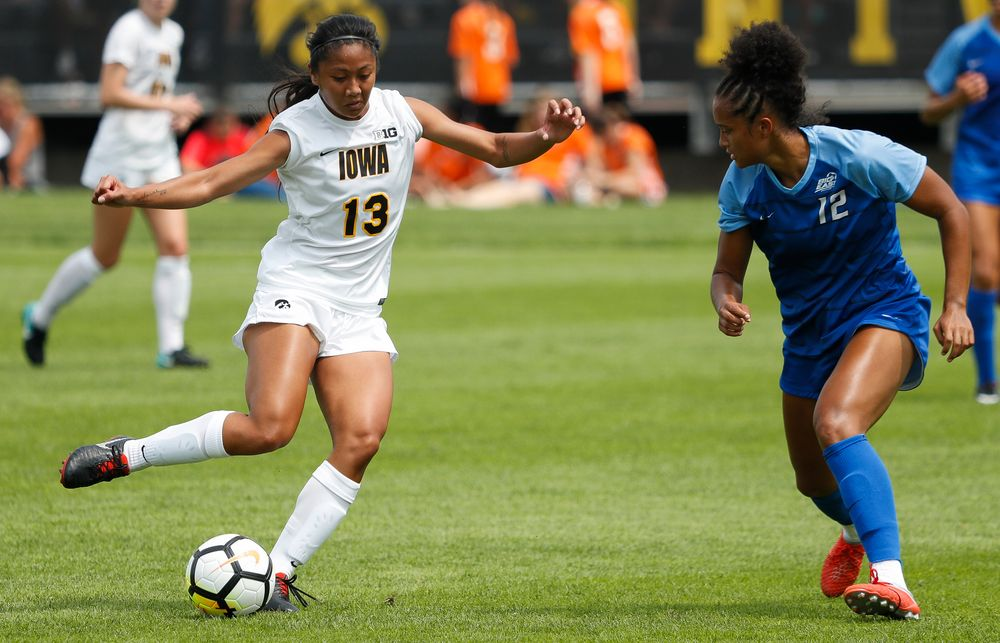 Iowa Hawkeyes forward Bianca Acuario (13)