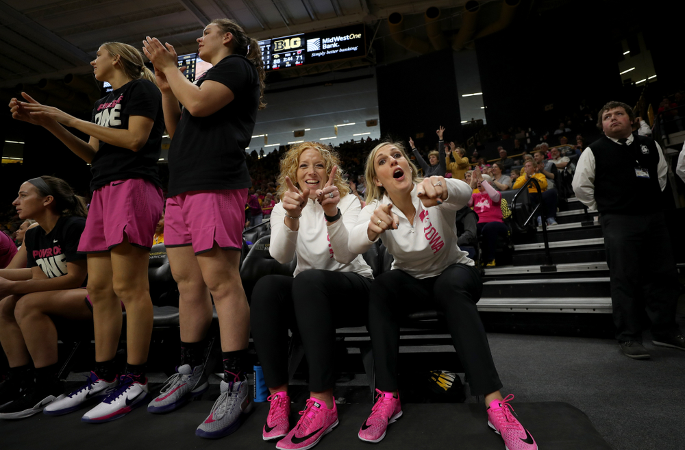 Athletic Trainer Jennie Sertterh and strength and conditioning coach Lindsay Dinkelman against the Wisconsin Badgers Sunday, February 16, 2020 at Carver-Hawkeye Arena. (Brian Ray/hawkeyesports.com)