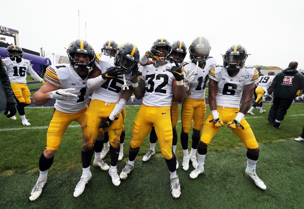 The Iowa Hawkeyes celebrate their victory against the Northwestern Wildcats Saturday, October 26, 2019 at Ryan Field in Evanston, Ill. (Brian Ray/hawkeyesports.com)