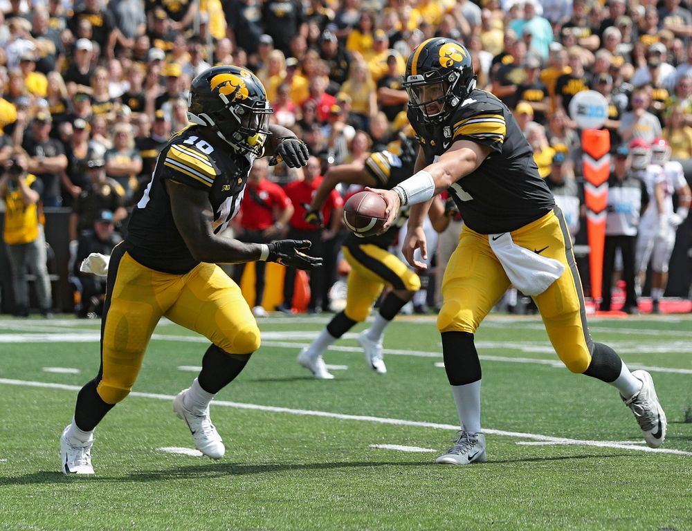 Iowa Hawkeyes quarterback Nate Stanley (4) hands off the ball to running back Mekhi Sargent (10) during the third quarter of their Big Ten Conference football game at Kinnick Stadium in Iowa City on Saturday, Sep 7, 2019. (Stephen Mally/hawkeyesports.com)