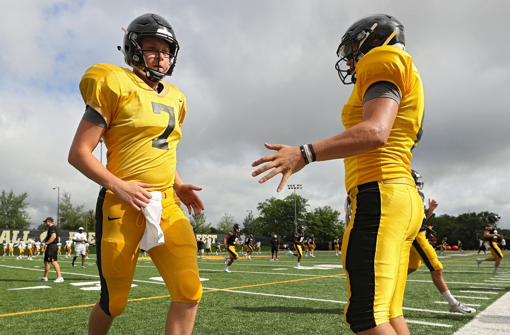 Iowa Hawkeyes quarterback Spencer Petras (7) is greeted by quarterback Nate Stanley (4) as they warm up during Fall Camp Practice No. 10 at the Hansen Football Performance Center in Iowa City on Tuesday, Aug 13, 2019. (Stephen Mally/hawkeyesports.com)