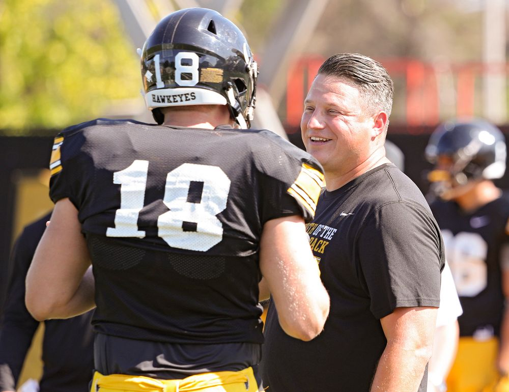 Iowa Hawkeyes tight end Drew Cook (18) talks with offensive coordinator Brian Ferentz during Fall Camp Practice #5 at the Hansen Football Performance Center in Iowa City on Tuesday, Aug 6, 2019. (Stephen Mally/hawkeyesports.com)