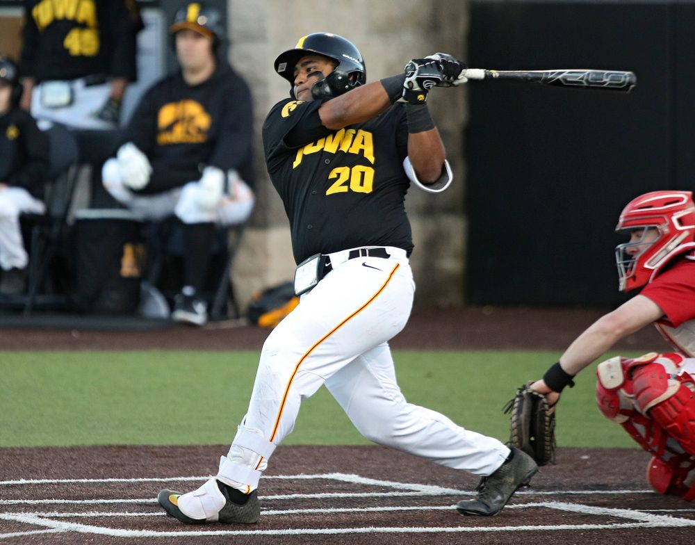 Iowa infielder Izaya Fullard (20) gets a hit during the fifth inning of their game at Duane Banks Field in Iowa City on Tuesday, March 3, 2020. (Stephen Mally/hawkeyesports.com)