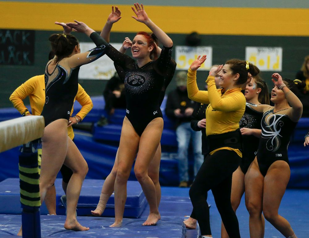 Maria Ortiz celebrates after Lanie Snyder's balance beam routine during the Black and Gold Intrasquad meet at the Field House on 12/2/17. (Tork Mason/hawkeyesports.com)