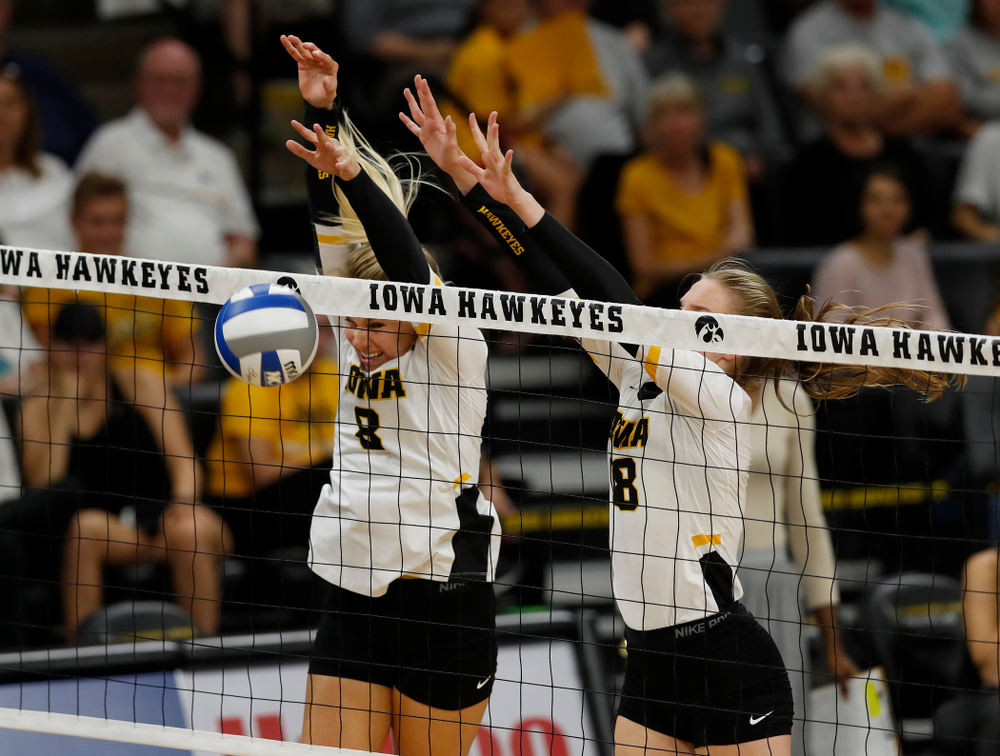 Iowa Hawkeyes middle blocker Hannah Clayton (18) and right side hitter Reghan Coyle (8) against Eastern Illinois Sunday, September 9, 2018 at Carver-Hawkeye Arena. (Brian Ray/hawkeyesports.com)