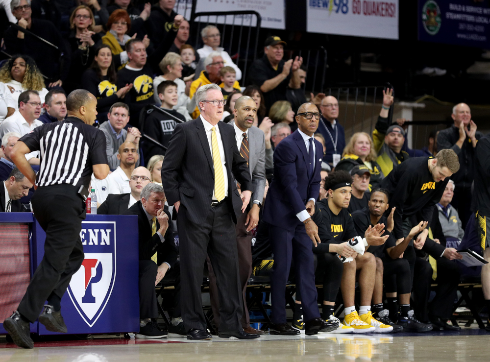 Iowa Hawkeyes head coach Fran McCaffery, assistant coach Billy Taylor, and assistant coach Sherman Dillard against Penn State Saturday, January 4, 2020 at the Palestra in Philadelphia. (Brian Ray/hawkeyesports.com)
