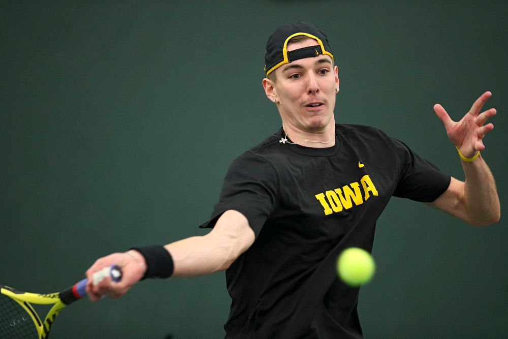 Iowa's Nikita Snezhko lines up a shot during his doubles match at the Hawkeye Tennis and Recreation Complex in Iowa City on Friday, February 14, 2020. (Stephen Mally/hawkeyesports.com)