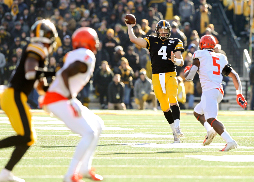 Iowa Hawkeyes quarterback Nate Stanley (4) throws on the run during the fourth quarter of their game at Kinnick Stadium in Iowa City on Saturday, Nov 23, 2019. (Stephen Mally/hawkeyesports.com)
