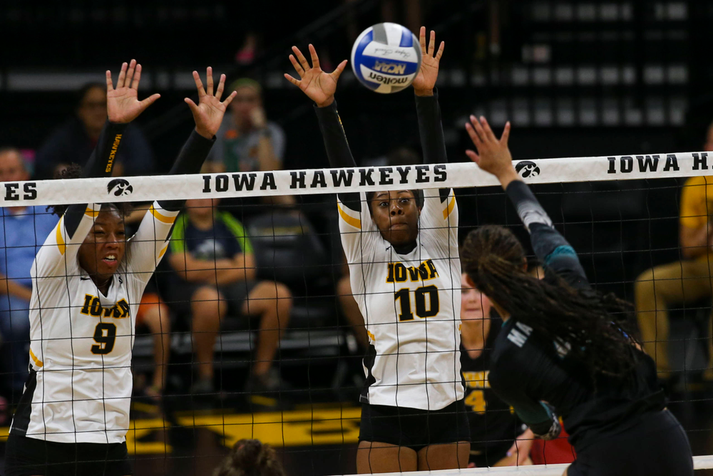 Iowa Hawkeyes middle blocker Amiya Jones (9) and Iowa Hawkeyes outside hitter Griere Hughes (10) against Coastal Carolina Friday, September 20, 2019 at Carver-Hawkeye Arena. (Lily Smith/hawkeyesports.com)
