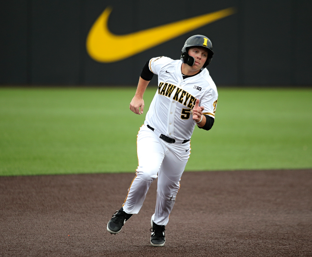 Iowa outfielder Zeb Adreon (5) runs between second and third base during the fourth inning of their college baseball game at Duane Banks Field in Iowa City on Wednesday, March 11, 2020. (Stephen Mally/hawkeyesports.com)