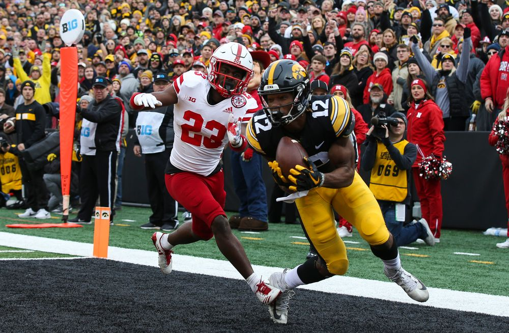 Iowa Hawkeyes wide receiver Brandon Smith (12) makes a touchdown catch during a game against Nebraska at Kinnick Stadium on November 23, 2018. (Tork Mason/hawkeyesports.com)