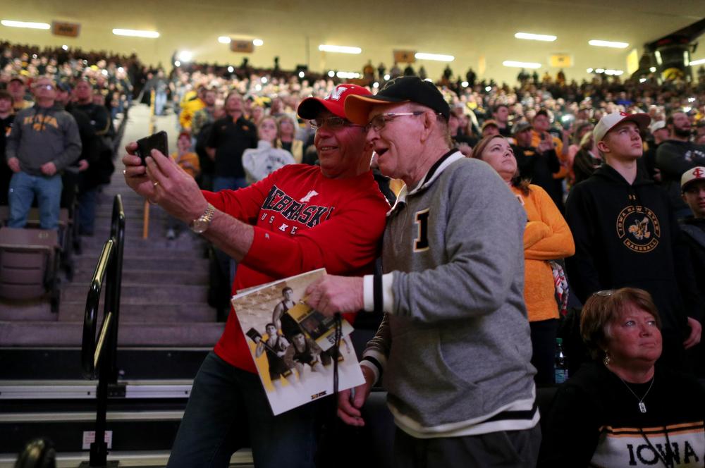A Nebraska fan takes a selfie with legendary former Hawkeyes Head Coach Dan Gable before their meet Saturday, January 18, 2020 at Carver-Hawkeye Arena. (Brian Ray/hawkeyesports.com)