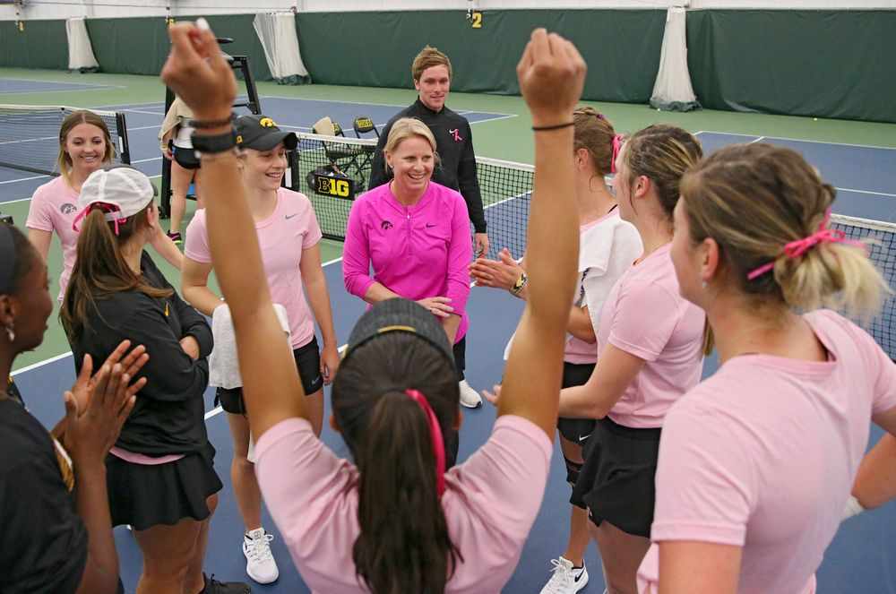 Iowa head coach Sasha Schmid talks with her team after their match against Purdue at the Hawkeye Tennis and Recreation Complex in Iowa City on Friday, Mar. 29, 2019. (Stephen Mally/hawkeyesports.com)