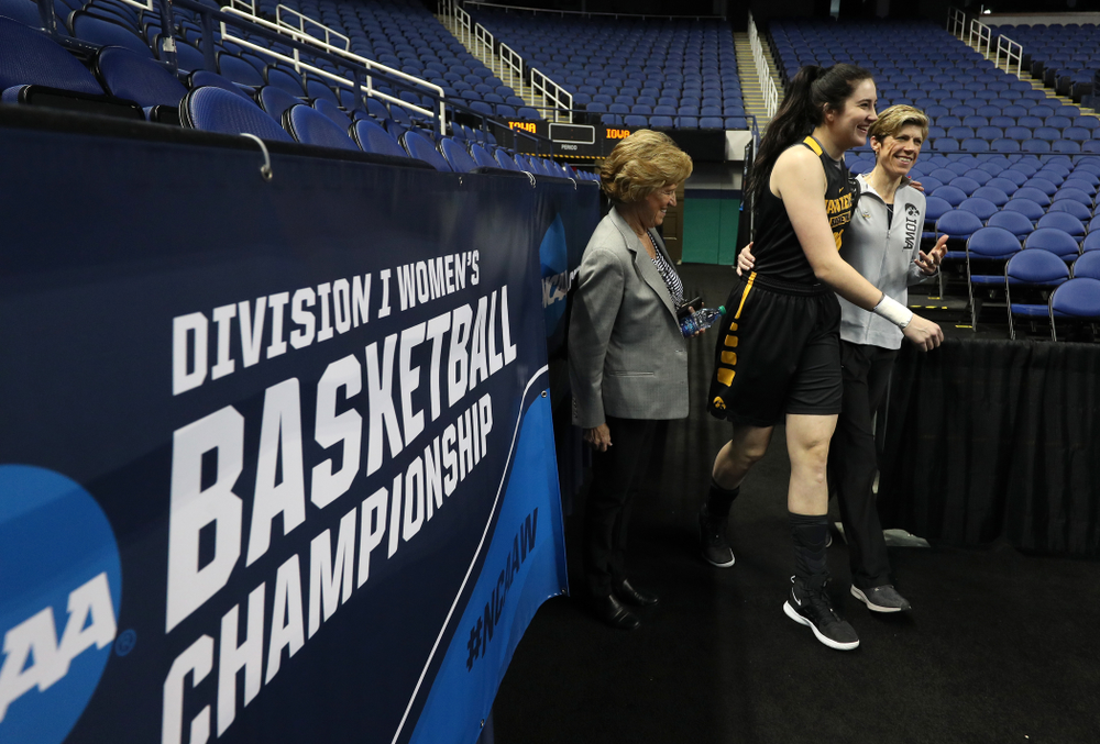 Iowa Hawkeyes forward Megan Gustafson (10) and associate head coach Jan Jensen during media and practice as they prepare for their Sweet 16 matchup against NC State Friday, March 29, 2019 at the Greensboro Coliseum in Greensboro, NC.(Brian Ray/hawkeyesports.com)