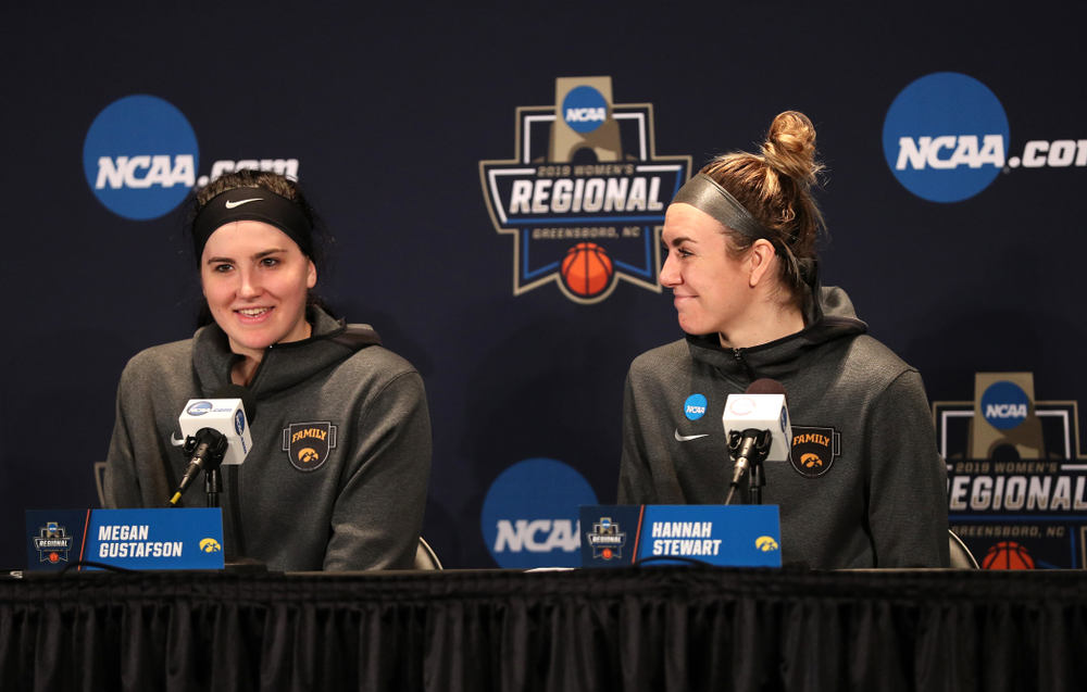 Iowa Hawkeyes forward Megan Gustafson (10) and forward Hannah Stewart (21) against the NC State Wolfpack in the regional semi-final of the 2019 NCAA Women's College Basketball Tournament Saturday, March 30, 2019 at Greensboro Coliseum in Greensboro, NC.(Brian Ray/hawkeyesports.com)
