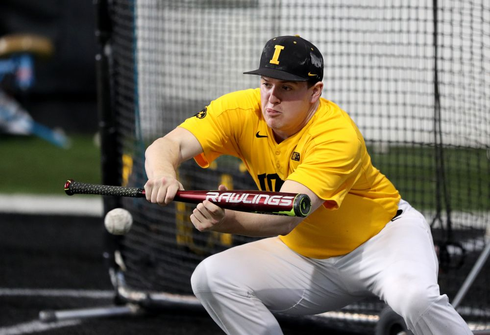 Iowa Hawkeyes first baseman Peyton Williams (45) puts down a bunt during practice Thursday, February 6, 2020 at the Indoor Practice Facility. (Brian Ray/hawkeyesports.com)