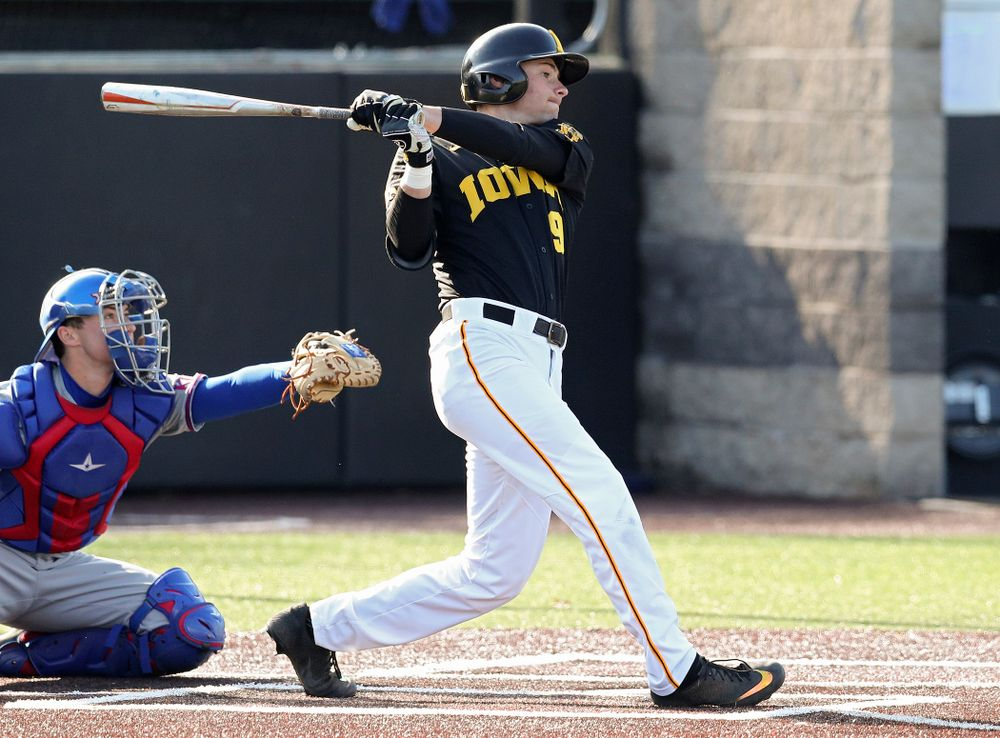 Iowa outfielder Ben Norman (9) drives a pitch for a hit during the first inning of their college baseball game at Duane Banks Field in Iowa City on Tuesday, March 10, 2020. (Stephen Mally/hawkeyesports.com)