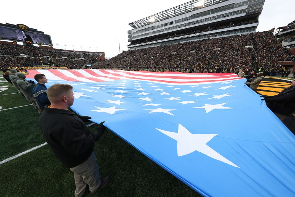 Veterans hold a large American flag before the Iowa Hawkeyes game against the Northwestern Wildcats Saturday, November 10, 2018 at Kinnick Stadium. (Brian Ray/hawkeyesports.com)