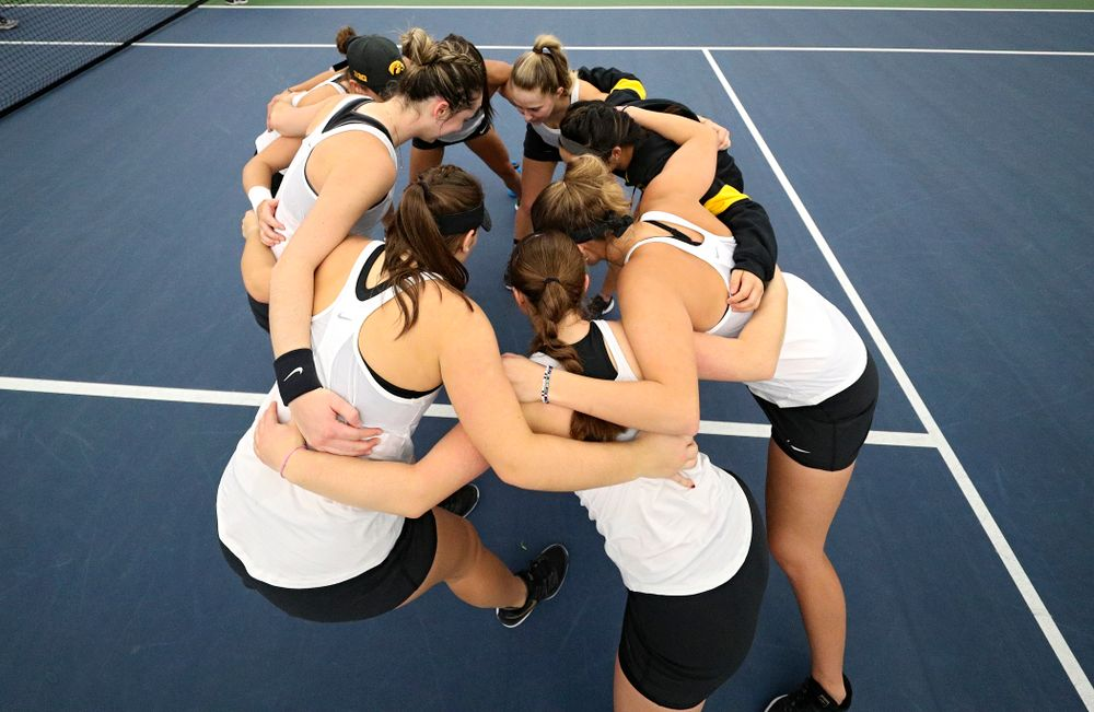 The Hawkeyes huddle before their match at the Hawkeye Tennis and Recreation Complex in Iowa City on Sunday, February 23, 2020. (Stephen Mally/hawkeyesports.com)
