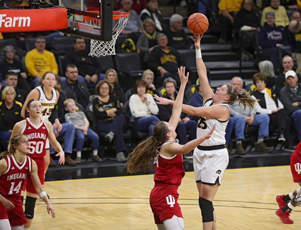 Iowa Hawkeyes forward Monika Czinano (25) makes a basket during the third quarter of their game at Carver-Hawkeye Arena in Iowa City on Sunday, January 12, 2020. (Stephen Mally/hawkeyesports.com)