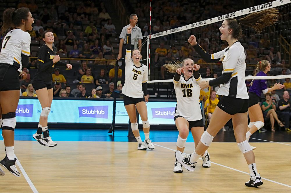 Iowa's Meghan Buzzerio (5) and Hannah Clayton (18) celebrate with Courtney Buzzerio (2) after her kill during their Big Ten/Pac-12 Challenge match at Carver-Hawkeye Arena in Iowa City on Saturday, Sep 7, 2019. (Stephen Mally/hawkeyesports.com)