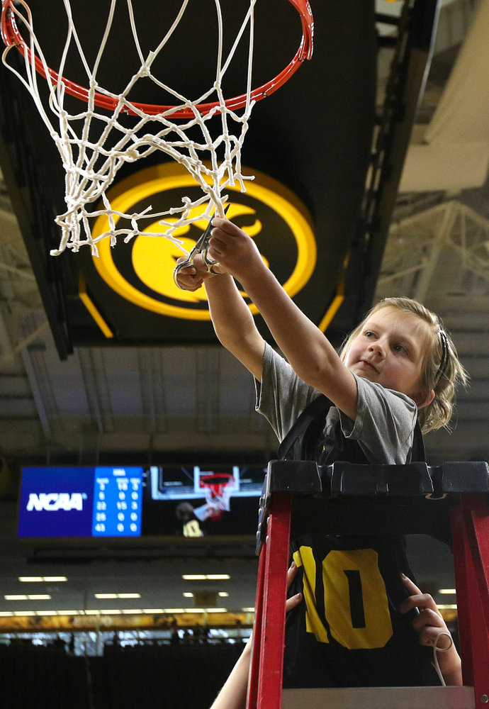 Harper Stribe cuts down the net after the Iowa Hawkeyes won their second round game in the 2019 NCAA Women's Basketball Tournament at Carver Hawkeye Arena in Iowa City on Sunday, Mar. 24, 2019. (Stephen Mally for hawkeyesports.com)
