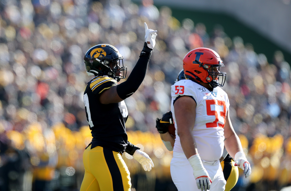 Iowa Hawkeyes defensive end Chauncey Golston (57) waves a finger after batting down a pass against the Illinois Fighting Illini Saturday, November 23, 2019 at Kinnick Stadium. (Brian Ray/hawkeyesports.com)