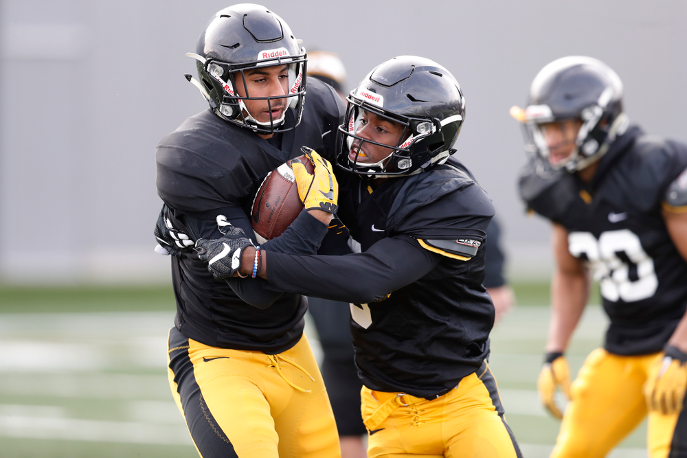 Iowa Hawkeyes defensive back Geno Stone (9) and defensive back Matt Hankins (8)