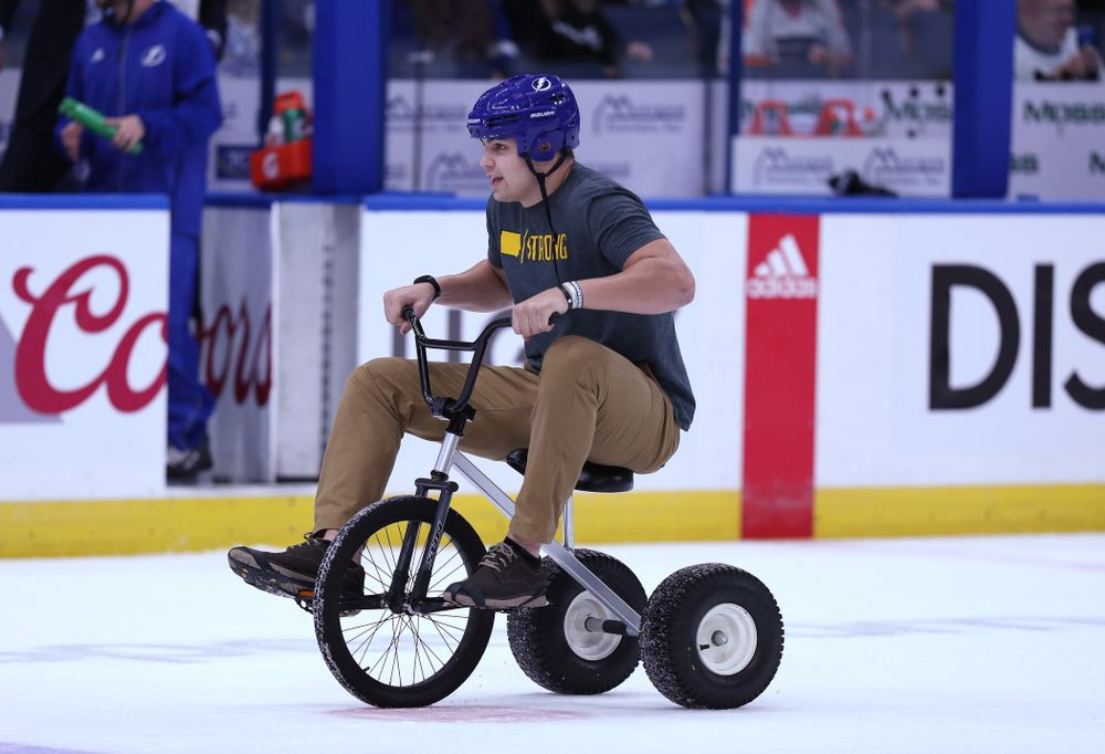 Iowa Hawkeyes quarterback Nate Stanley (4) rides a tricycle on the ice during a contest against Mississippi State in the first intermission of the Tampa Bay Lightning game Thursday, December 27, 2018 at Amalie Arena. (Brian Ray/hawkeyesports.com)