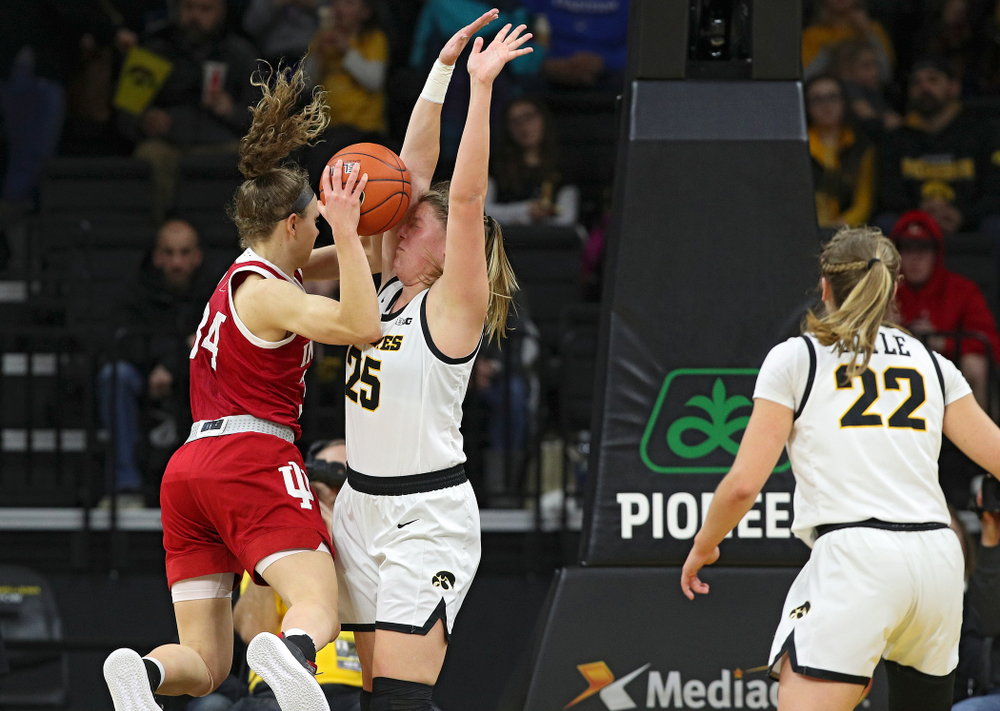 Iowa Hawkeyes forward Monika Czinano (25) holds her ground as Indiana Hoosiers guard Grace Berger (34) looses control of the ball for a turnover during the second quarter of their game at Carver-Hawkeye Arena in Iowa City on Sunday, January 12, 2020. (Stephen Mally/hawkeyesports.com)