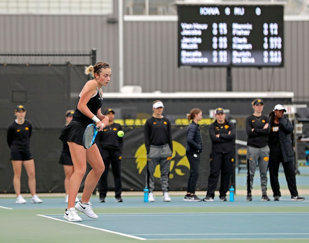 Iowa's Sophie Clark returns a shot as her teammates look on during a match against Rutgers at the Hawkeye Tennis and Recreation Complex in Iowa City on Friday, Apr. 5, 2019. (Stephen Mally/hawkeyesports.com)
