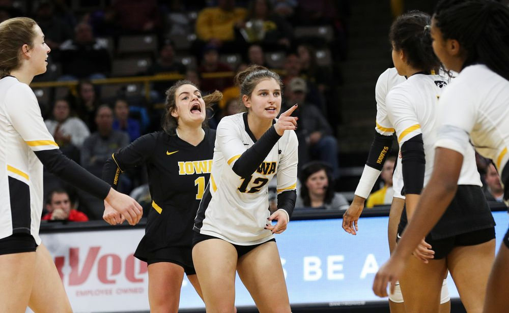 Iowa Hawkeyes defensive specialist Molly Kelly (1) and Iowa Hawkeyes defensive specialist Emily Bushman (12) celebrate after winning a point during a match against Maryland at Carver-Hawkeye Arena on November 23, 2018. (Tork Mason/hawkeyesports.com)
