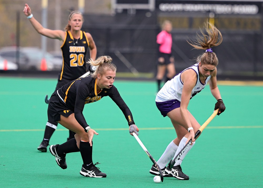 Iowa's Leah Zellner (13) battles for position on the ball during the third quarter of their game at Grant Field in Iowa City on Saturday, Oct 26, 2019. (Stephen Mally/hawkeyesports.com)