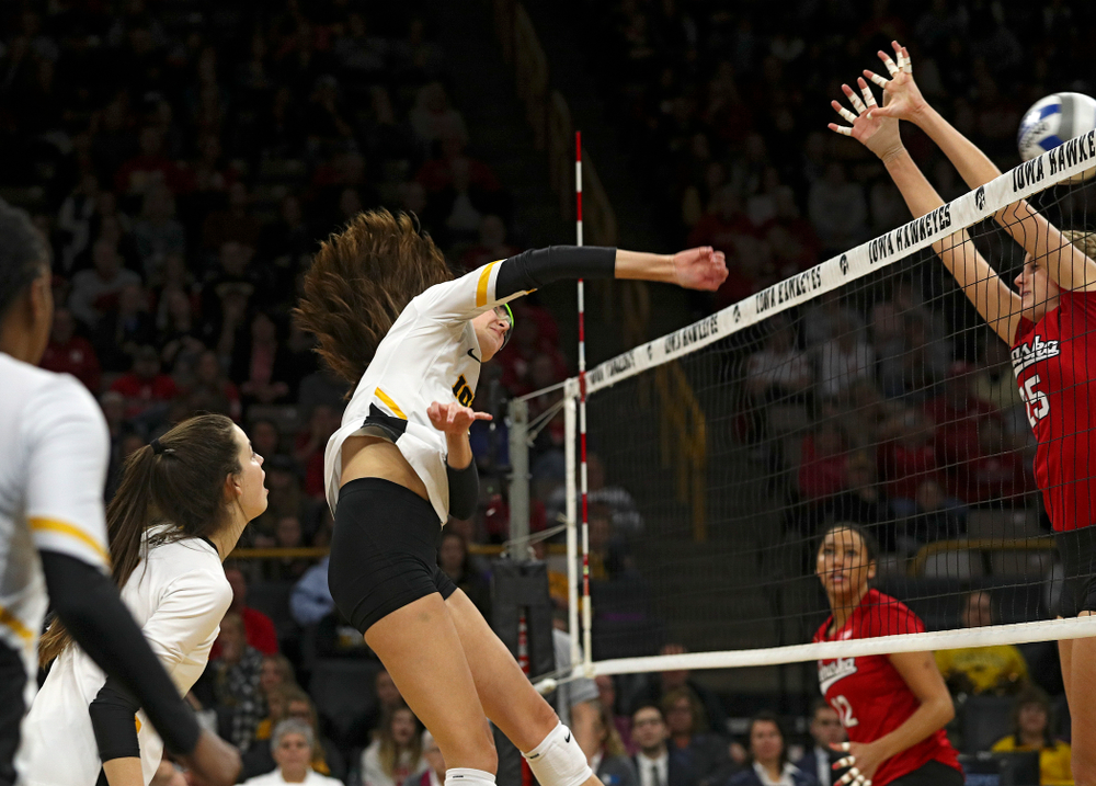 Iowa's Grace Tubbs (16) gets a kill during the second set of their match against Nebraska at Carver-Hawkeye Arena in Iowa City on Saturday, Nov 9, 2019. (Stephen Mally/hawkeyesports.com)