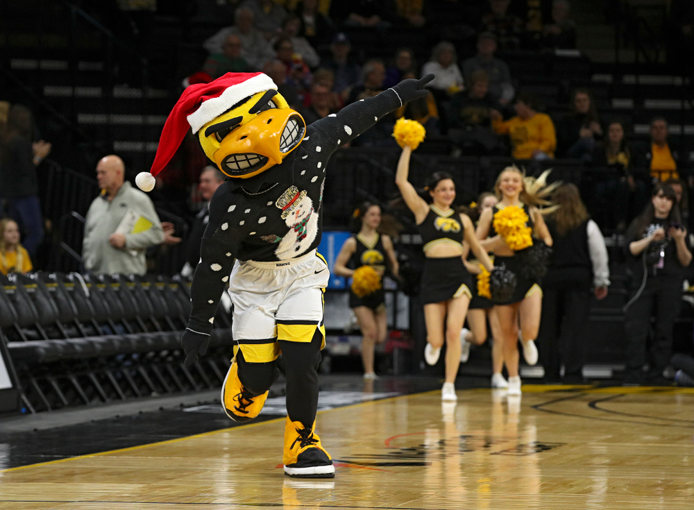 Herky runs onto the court before their game at Carver-Hawkeye Arena in Iowa City on Saturday, December 21, 2019. (Stephen Mally/hawkeyesports.com)