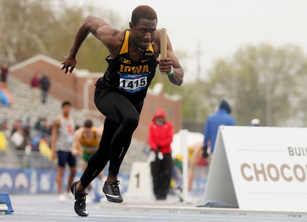 Iowa's Karayme Bartley runs the men's sprint medley relay event during the third day of the Drake Relays at Drake Stadium in Des Moines on Saturday, Apr. 27, 2019. (Stephen Mally/hawkeyesports.com)