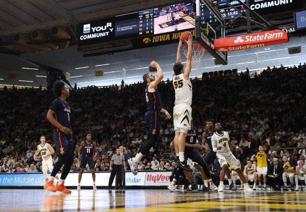 Iowa Hawkeyes forward Luka Garza (55) dunks the ball against the Illinois Fighting Illini Sunday, January 20, 2019 (Brian Ray/hawkeyesports.com)