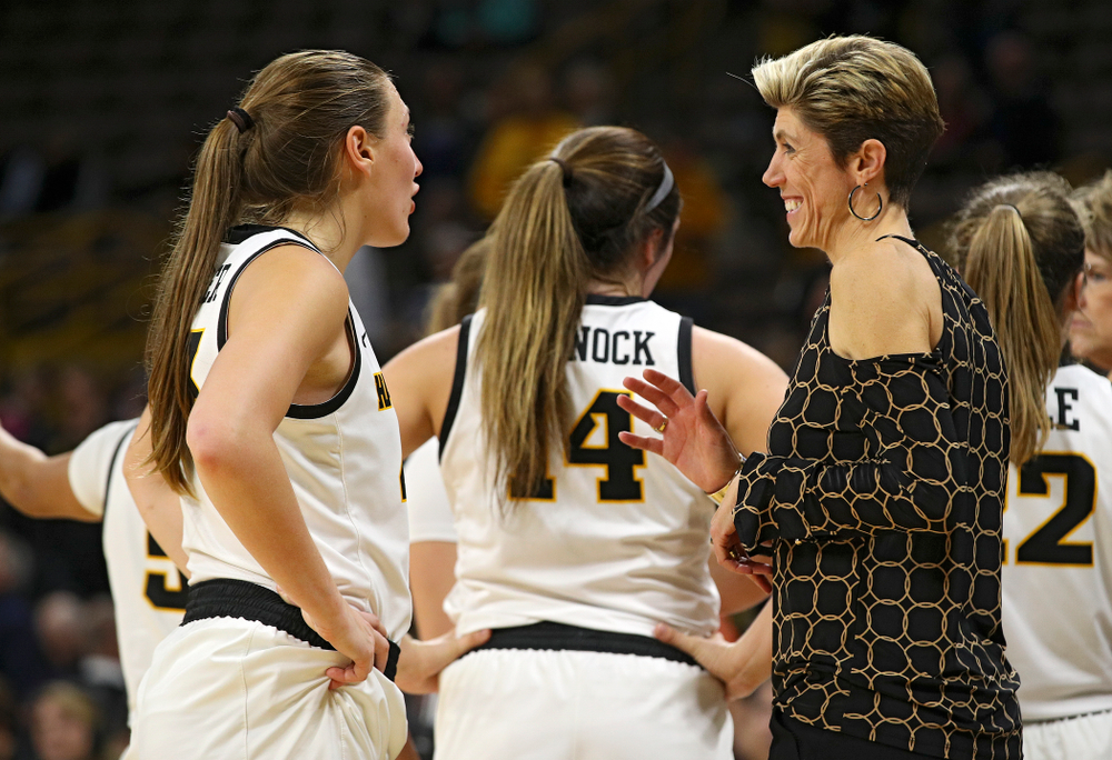 Iowa forward Amanda Ollinger (43) talks with associate head coach Jan Jensen during overtime in their win against Princeton at Carver-Hawkeye Arena in Iowa City on Wednesday, Nov 20, 2019. (Stephen Mally/hawkeyesports.com)