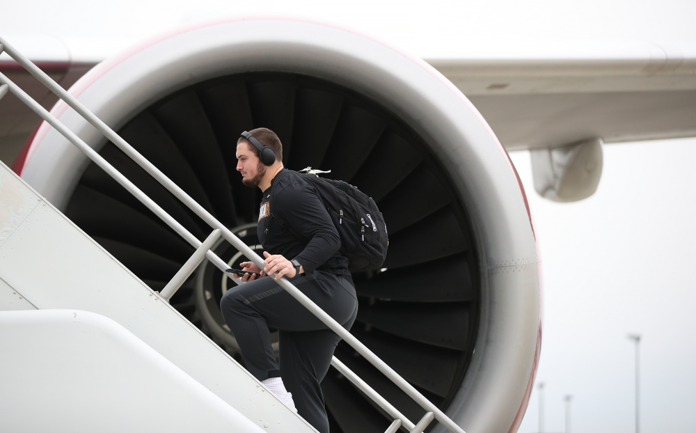 Iowa Hawkeyes offensive lineman Ross Reynolds (59) boards the team plane Wednesday, December 26, 2018 as they travel to Tampa, Florida for the Outback Bowl. (Brian Ray/hawkeyesports.com)