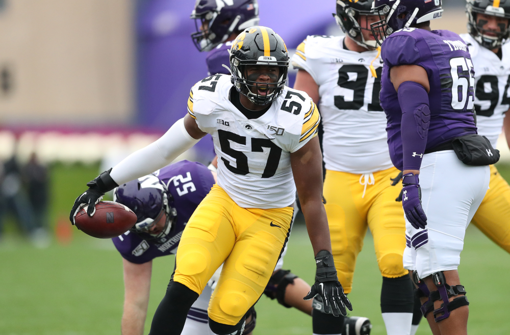 Iowa Hawkeyes defensive end Chauncey Golston (57) celebrates after intercepting a pass against the Northwestern Wildcats Saturday, September 28, 2019 at Kinnick Stadium. (Max Allen/hawkeyesports.com)