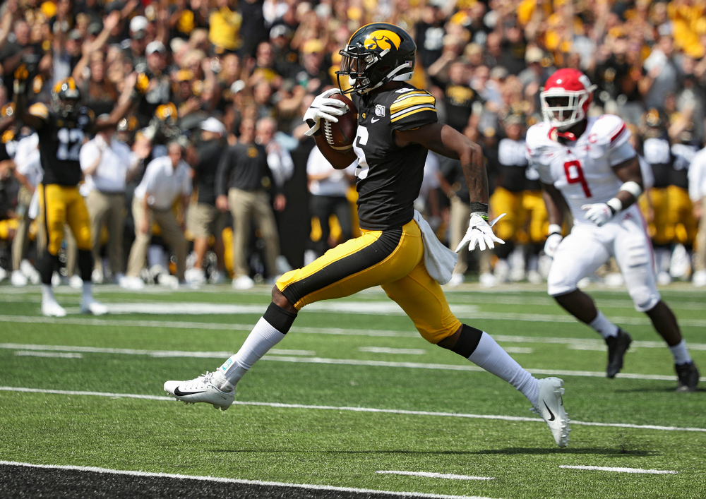 Iowa Hawkeyes wide receiver Ihmir Smith-Marsette (6) high steps to the end zone on a 23-yard touchdown reception during the third quarter of their Big Ten Conference football game at Kinnick Stadium in Iowa City on Saturday, Sep 7, 2019. (Stephen Mally/hawkeyesports.com)