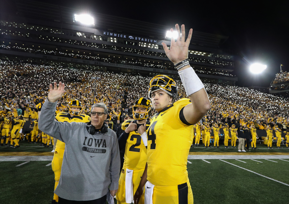 Iowa Hawkeyes quarterback Nate Stanley (4) and quarterbacks coach Ken O'Keefe  wave to the Stead Family ChildrenÕs Hospital against the Penn State Nittany Lions Saturday, October 12, 2019 at Kinnick Stadium. (Brian Ray/hawkeyesports.com)