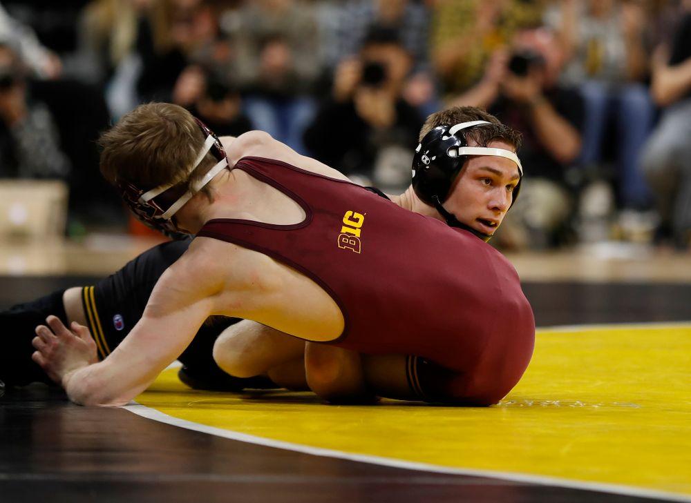 Iowa's Spencer Lee wrestles Minnesota's Ethan Lizak at 125 pounds