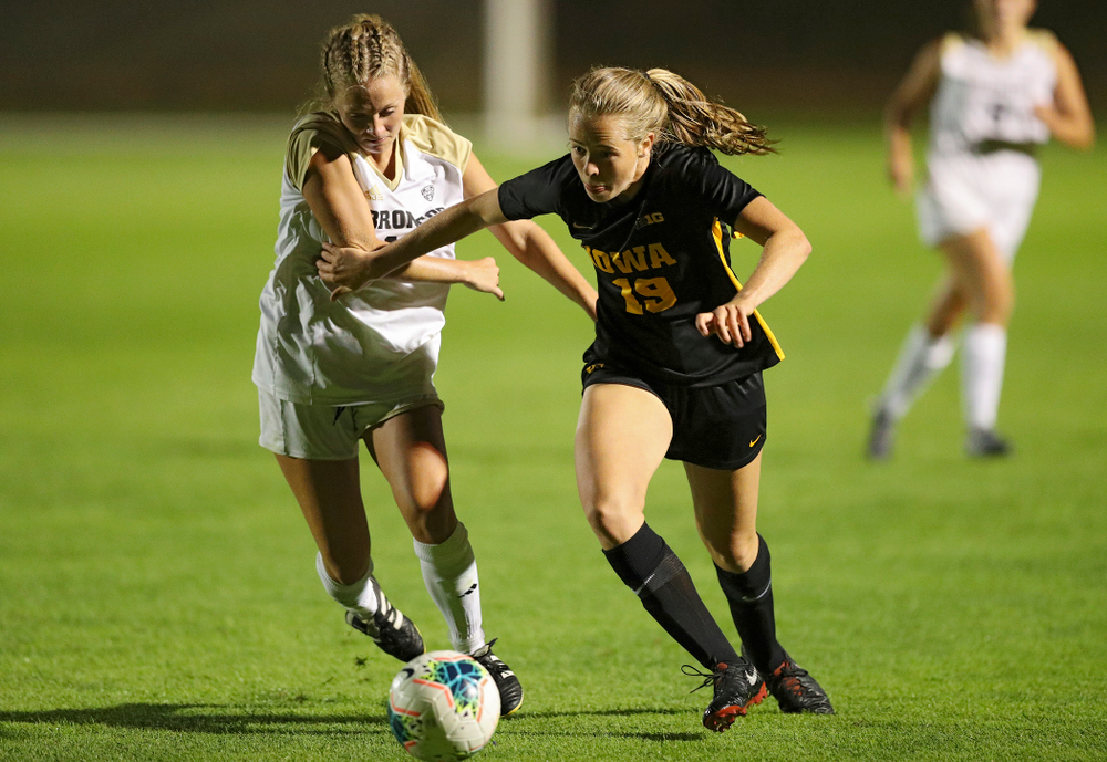 Iowa forward Jenny Cape (19) sprints towards the ball during the second half of their match against Western Michigan at the Iowa Soccer Complex in Iowa City on Thursday, Aug 22, 2019. (Stephen Mally/hawkeyesports.com)