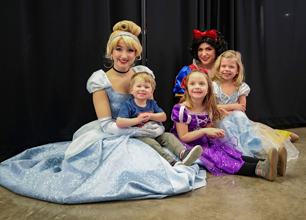 Three young fans get a picture with two princesses on Superhero and Princess Day before the meet at Carver-Hawkeye Arena in Iowa City on Sunday, March 8, 2020. (Stephen Mally/hawkeyesports.com)