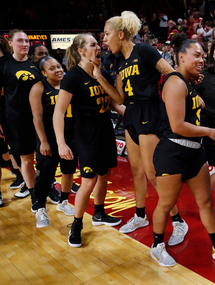 Iowa Hawkeyes guard Kathleen Doyle (22) and forward Chase Coley (4)