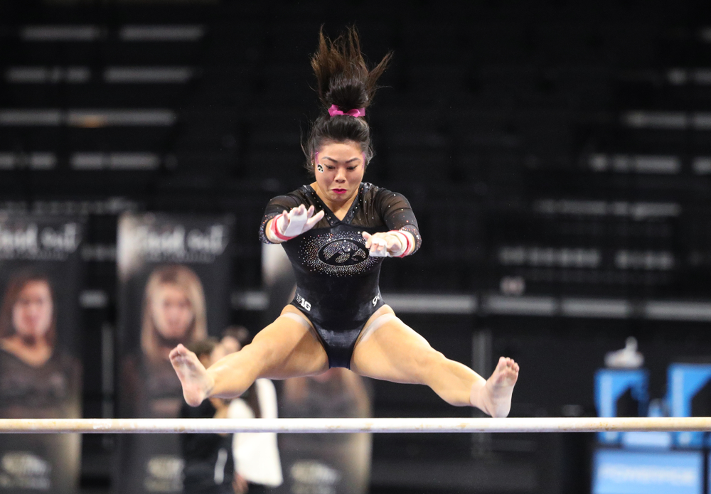 Iowa's Clair Kaji competes on the bars during their meet against the Minnesota Golden Gophers Saturday, January 19, 2019 at Carver-Hawkeye Arena. (Brian Ray/hawkeyesports.com)