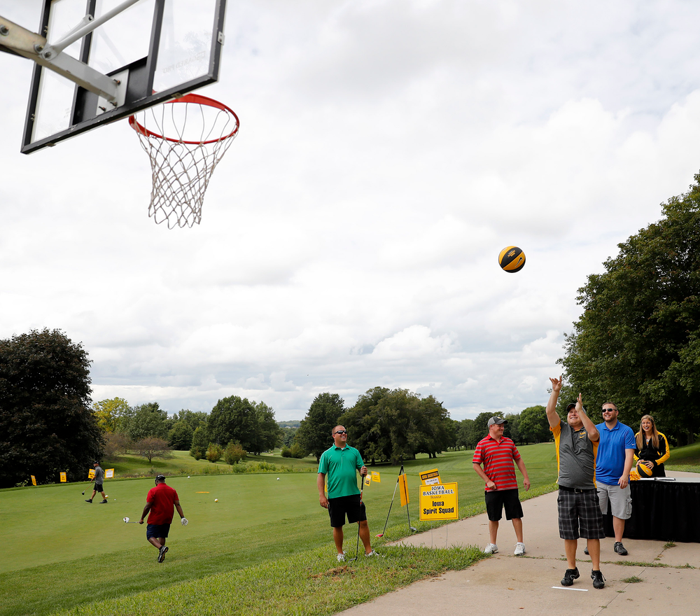 Shooting hoops for a prize.