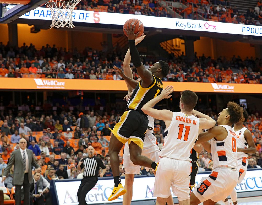 Iowa Hawkeyes guard Joe Toussaint (1) puts up a shot during the first half of their ACC/Big Ten Challenge game at the Carrier Dome in Syracuse, N.Y. on Tuesday, Dec 3, 2019. (Stephen Mally/hawkeyesports.com)