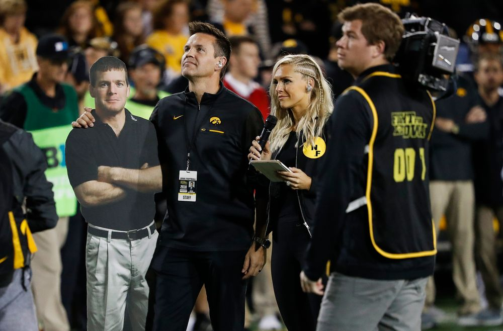 Iowa Hawkeyes volleyball head coach Bond Shymansky addresses the crowd in a timeout during a game against Wisconsin at Kinnick Stadium on September 22, 2018. (Tork Mason/hawkeyesports.com)
